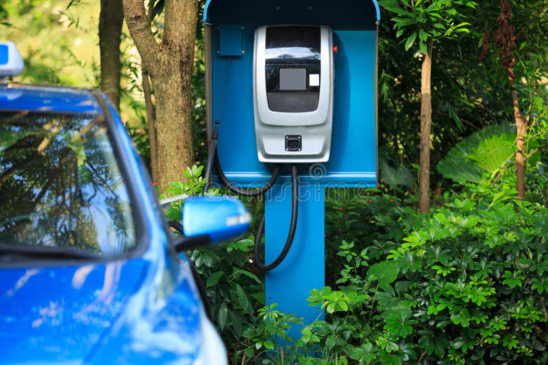Electric car charging at station royalty free stock image