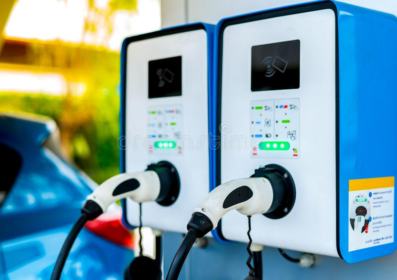 Electric car charging station. Plug for vehicle with electric motor. Coin-operated charging station. Clean energy power. royalty free stock photos