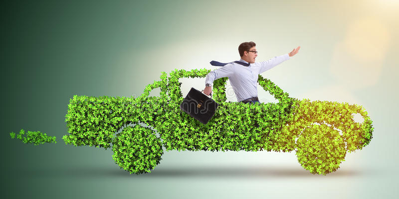The electric car concept in green environment concept stock images