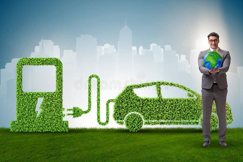 The electric car concept in green environment concept stock photography