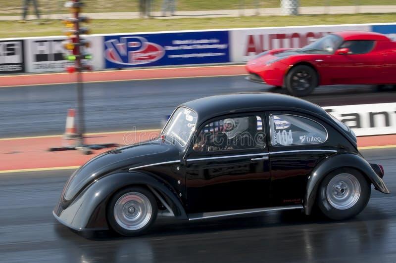 Electric car drag racing stock images
