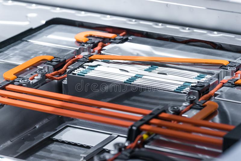 Electric car lithium battery pack and power connections. Blue toned. stock images