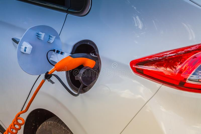 Electric car plug in stock photography
