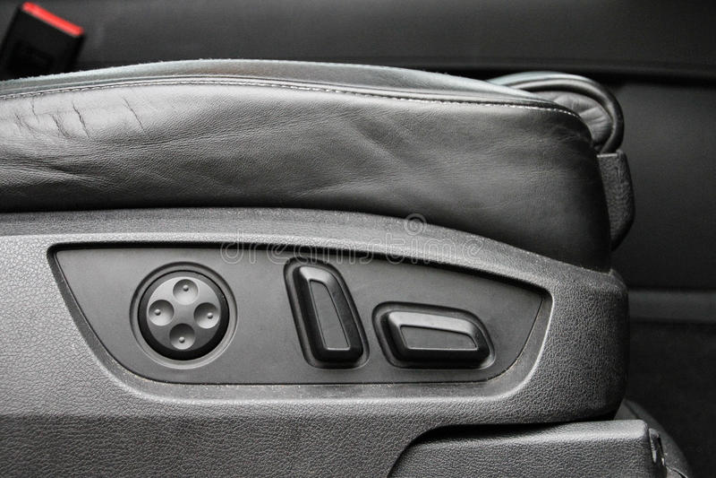 Electric car seat adjustment detail. Audi Q7 electric seat adjustment detail royalty free stock photography