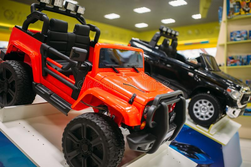Electric car on showcase in toy store, nobody stock images
