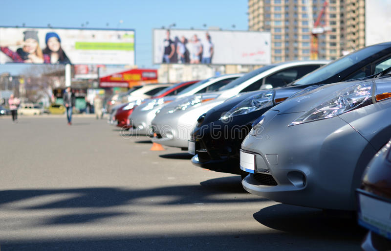 Electric cars on parking stock photos