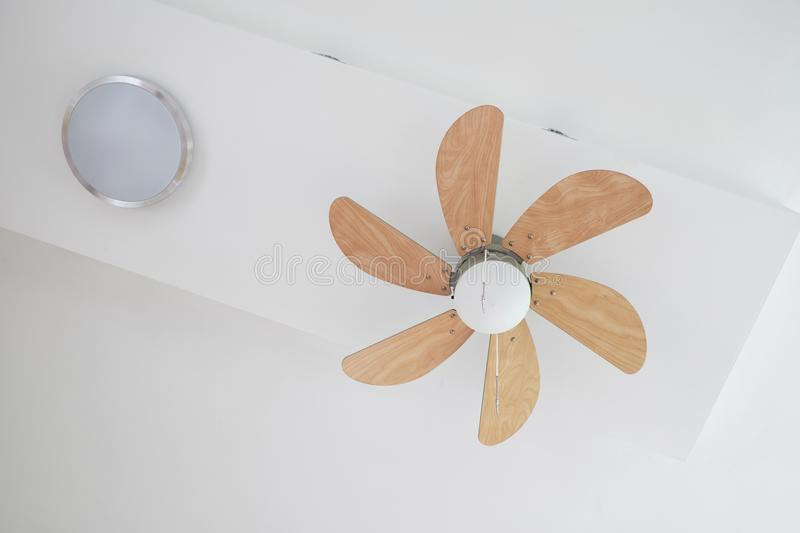 Electric ceiling fan with lamp royalty free stock photos
