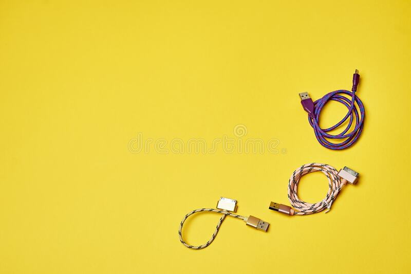 Electric charging for devices.Electronics. Minimalism. Yellow stock photos