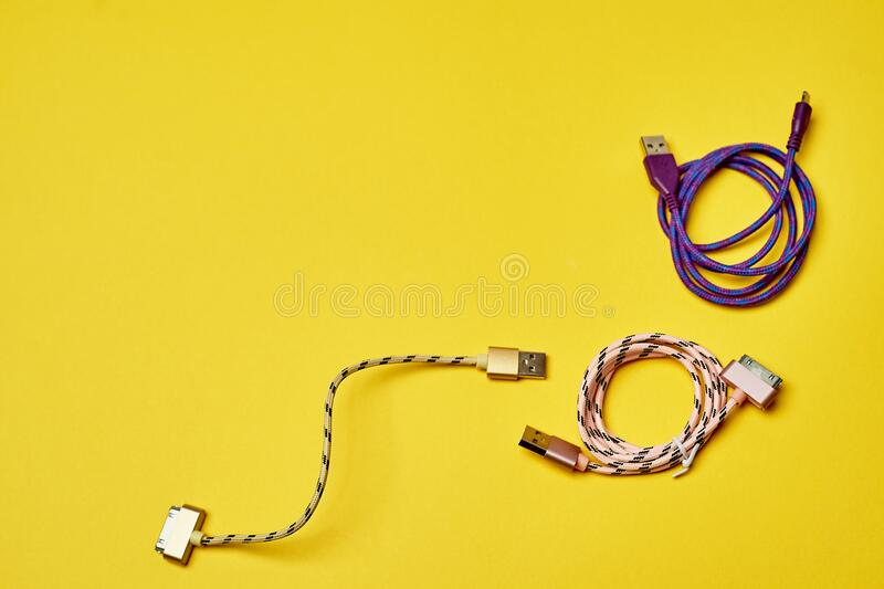 Electric charging for devices.Electronics. Minimalism. Yellow stock image
