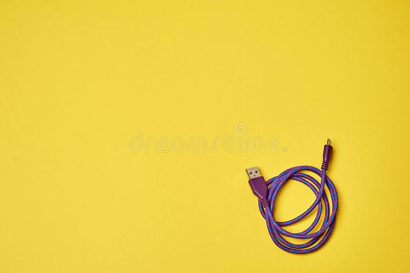 Electric charging for devices.Electronics. Minimalism. Yellow. Electric charging for devices.Electronics Minimalism royalty free stock images