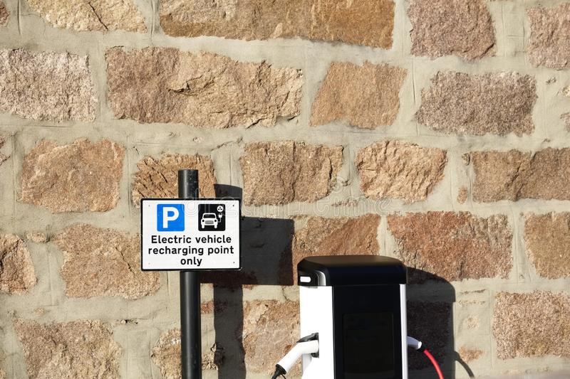 Electric charging point for vehicles cars bikes free no charge operated in shopping mall retail park in car parking space royalty free stock photo