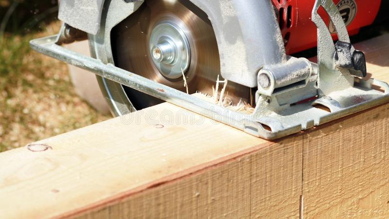 The circular saw. Electric circular saw for a wood cut royalty free stock photography