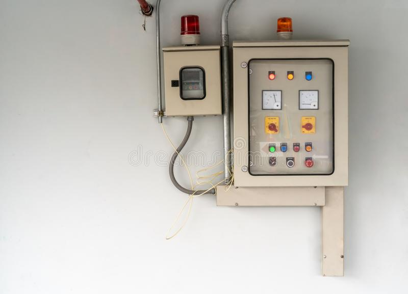 Electric city control panel in grey metal box hanging on wall. royalty free stock images