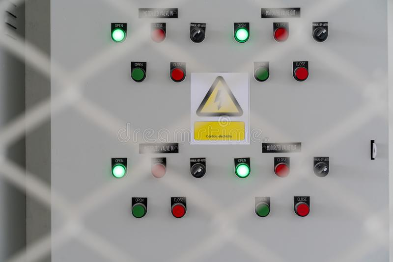 Electric city control panel in grey metal box hanging on wall royalty free stock image