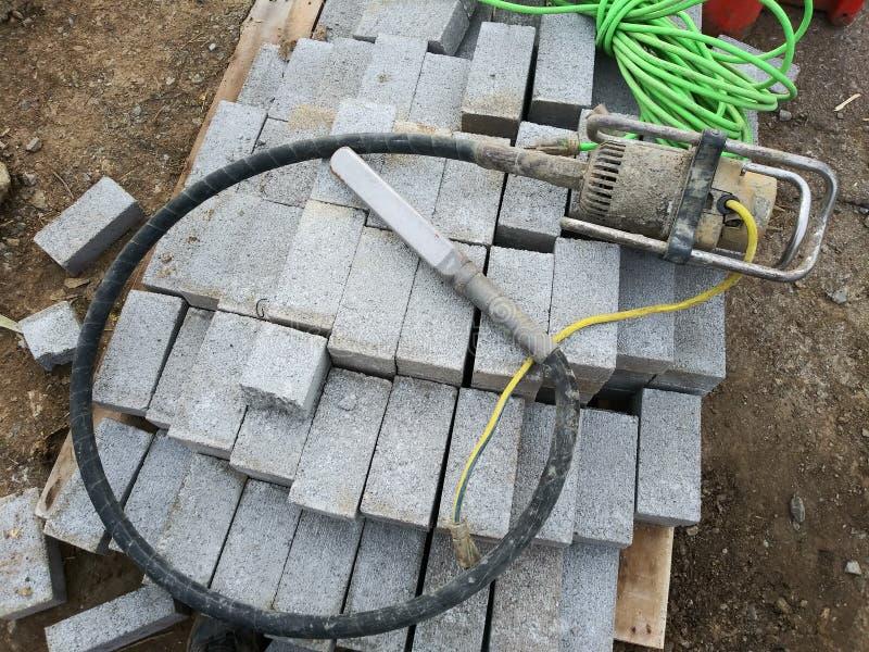 Concrete Vibrator. An electric concrete vibrator for vibrating concrete while pouring it stock photos