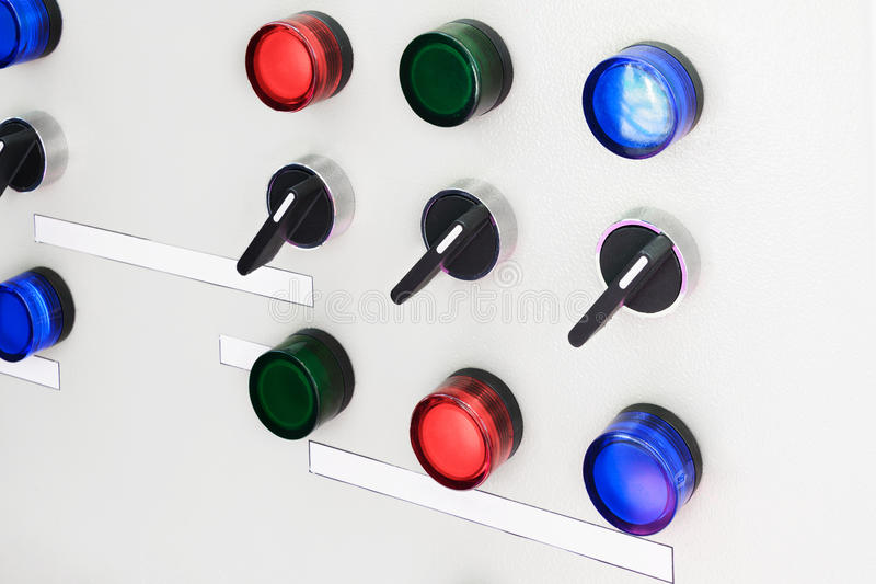Electric control panel with switches. And signal lamps stock photos