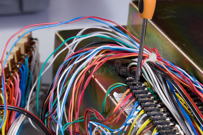 Electric device. Being repaired by an electrician stock images