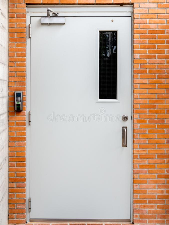 Electric door with digital lock on brick wall background royalty free stock photo