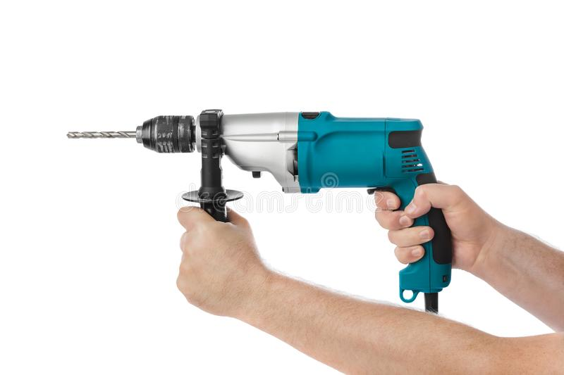 Electric drill in hands stock photos