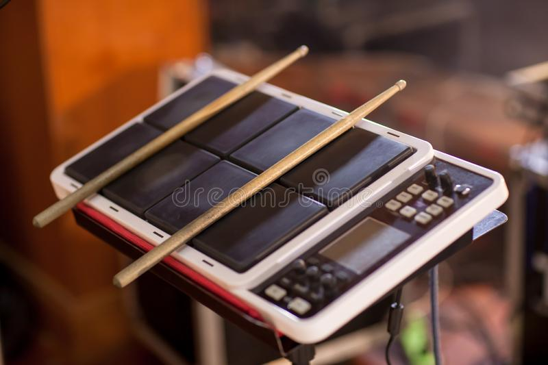 Electric drum digital drum music instrument. Drum sticks on a Electric drum background. Electric drum digital drum music instrument. Drum sticks on a Electric stock photography