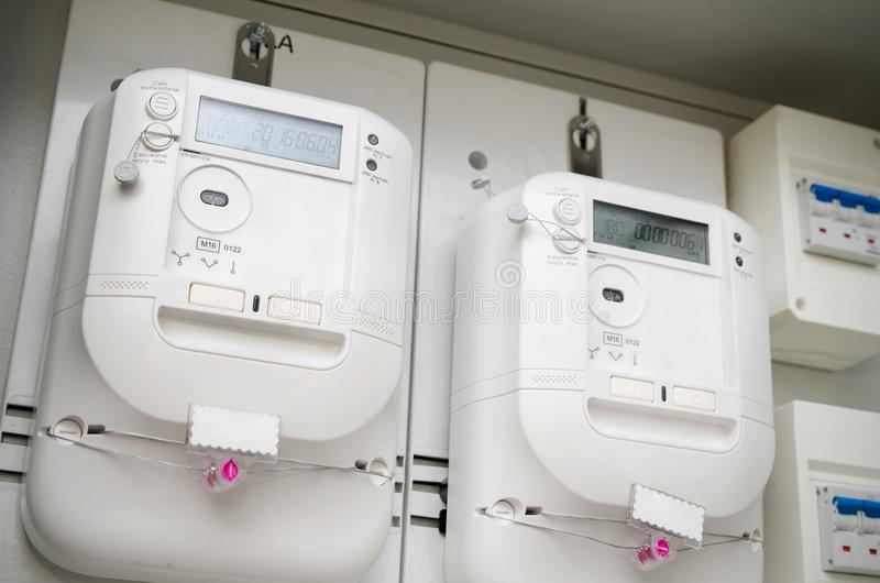 Electric energy meter. Pair of electrical units royalty free stock photography