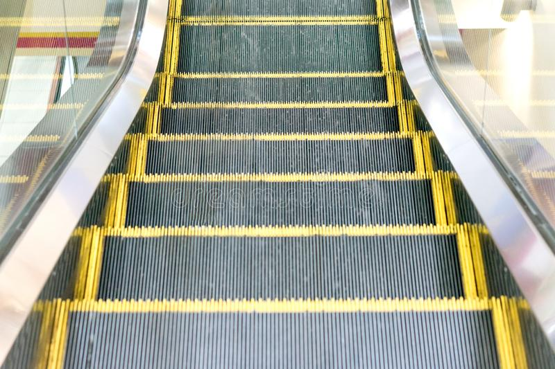 Electric Escalator. Close up - floor platform - yellow bands. gray metal steel line. Way up.  royalty free stock photo