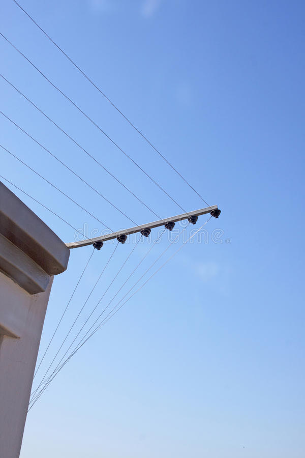 Electric Fence Installaton On Corner Of Concrete Wall stock image
