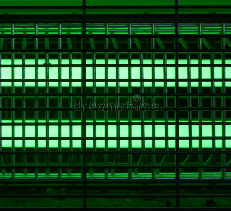 Bright green glowing UV lamp. Electric insect trap stock photography