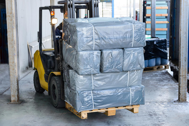 Electric forklift carries boxes. stock photo
