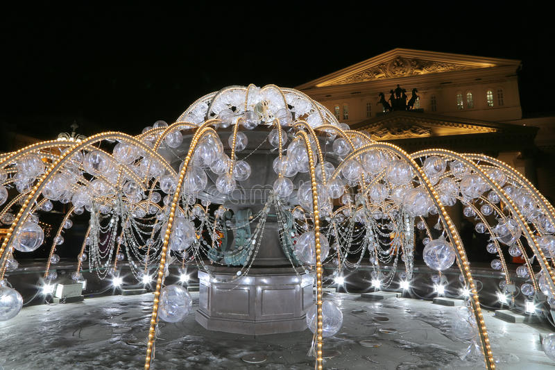Electric fountain at night, lighted during christmas near the Bolshoi Theatre, Moscow, Russia. Electric fountain at night, lighted during christmas near the stock photo