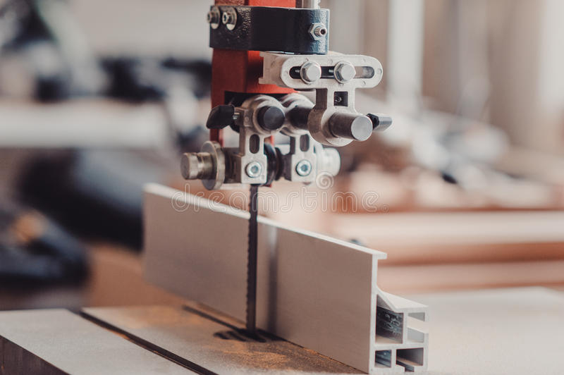 Electric fret saw for cutting wood closeup royalty free stock photography