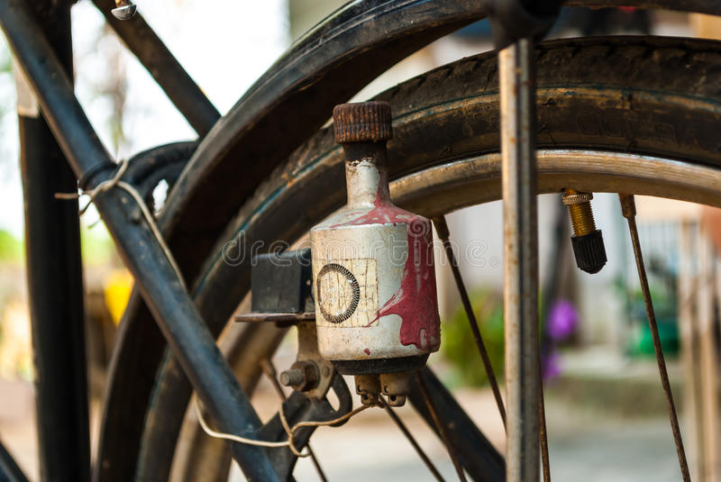 Electric generator (dynamo) on antique bicycle stock images