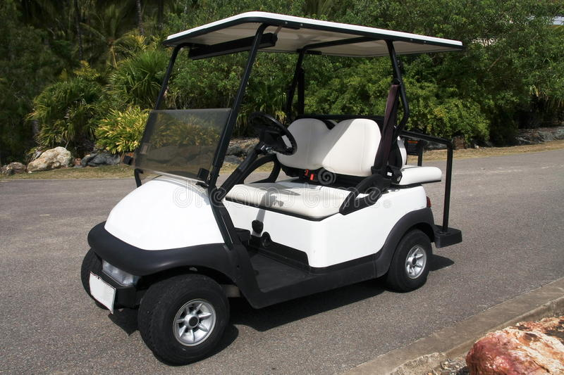 Electric golf cart parked on road. Holiday resort electric golf cart parked on road royalty free stock image