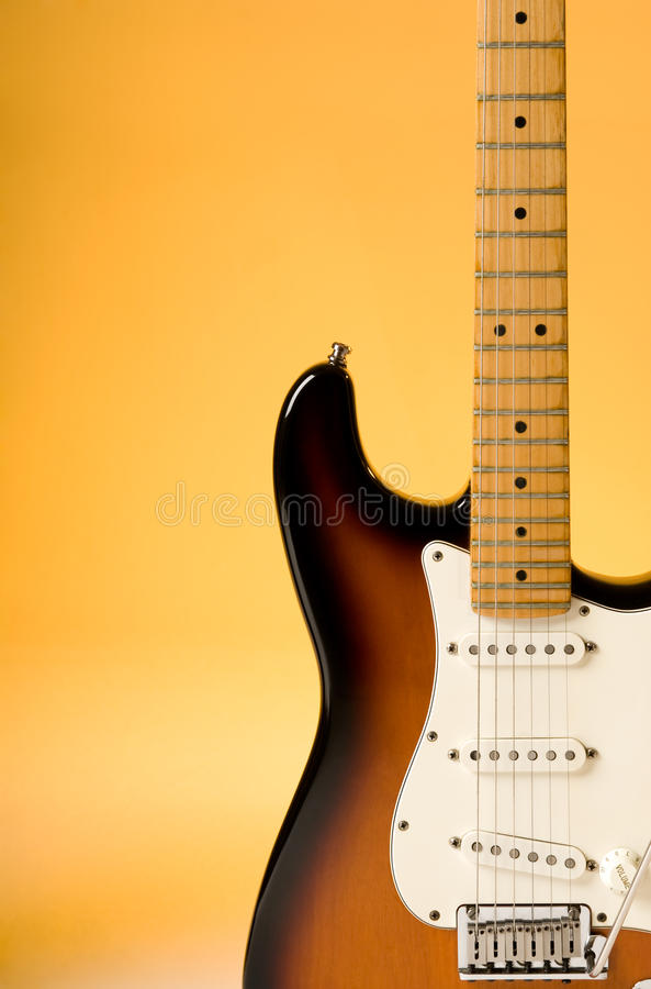 Electric Guitar. Detail with orange lighting royalty free stock image