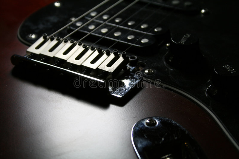 Electric Guitar. Image of a cherry red polished finish and hardware on an electric guitar royalty free stock photos