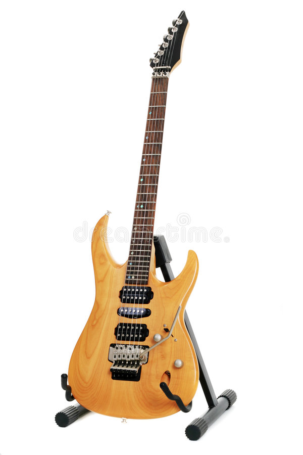 Electric guitar. Toned maple body electric guitar isolated on white background royalty free stock images