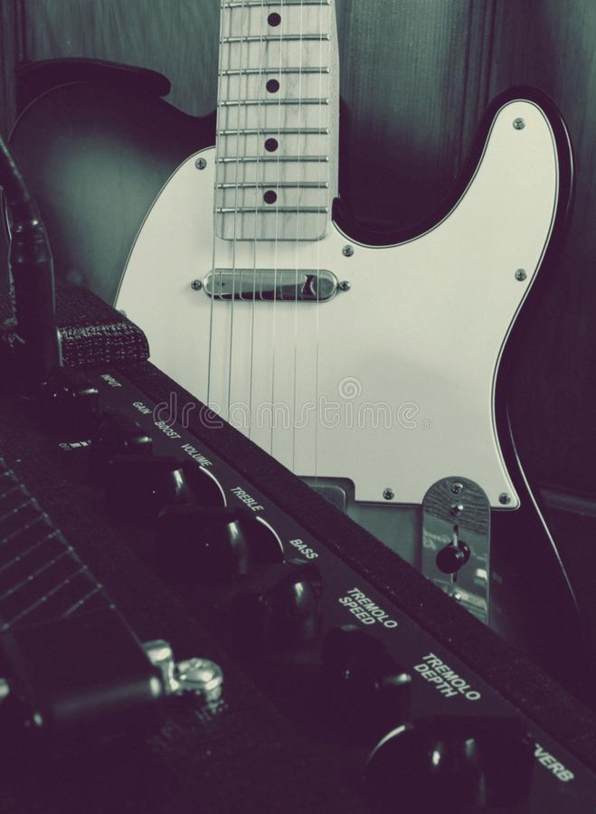 Electric guitar and amp close up filtered royalty free stock images