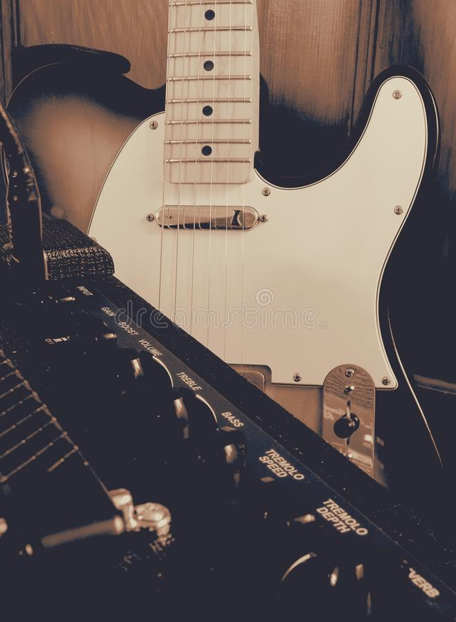 Electric guitar and amp close up filtered royalty free stock image