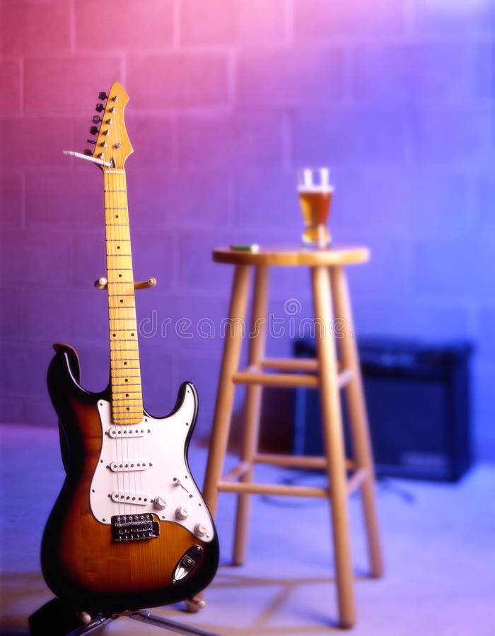 Electric guitar in bar scene royalty free stock images