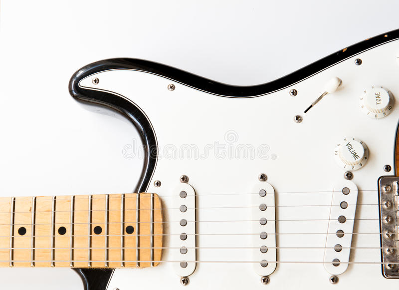 Electric guitar body part close up. Horizontal electric guitar body part close up with body knobs and neck on white background royalty free stock photos