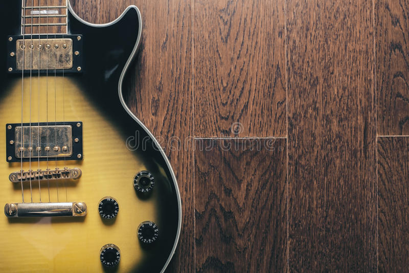 Electric guitar on brown surface royalty free stock photos
