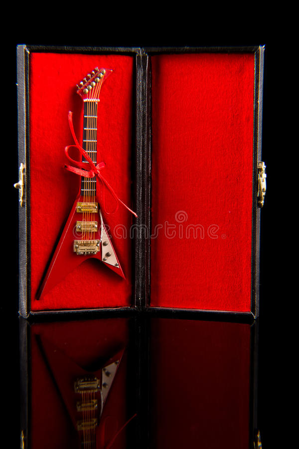 Electric guitar on case. See my other works in portfolio stock photography