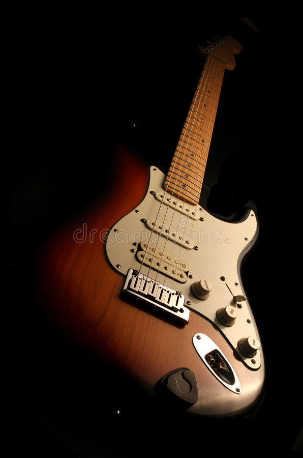 Electric guitar isolated. On the black stock photos