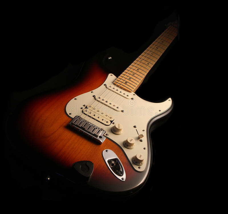 Electric guitar isolated. On black royalty free stock photos