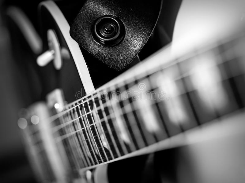 Electric guitar macro abstract black and white. Macro abstract black and white photo of the neck and frets of an electric guitar stock photo