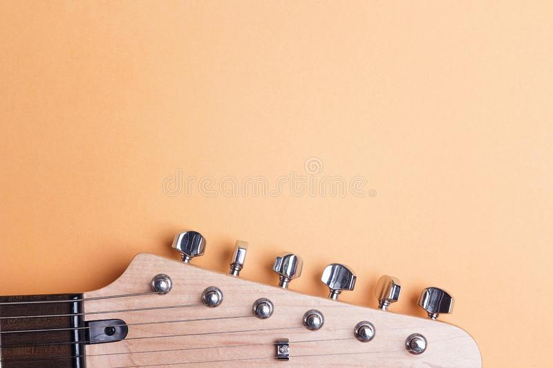 Electric guitar neck on yellow background with copy space. royalty free stock photography