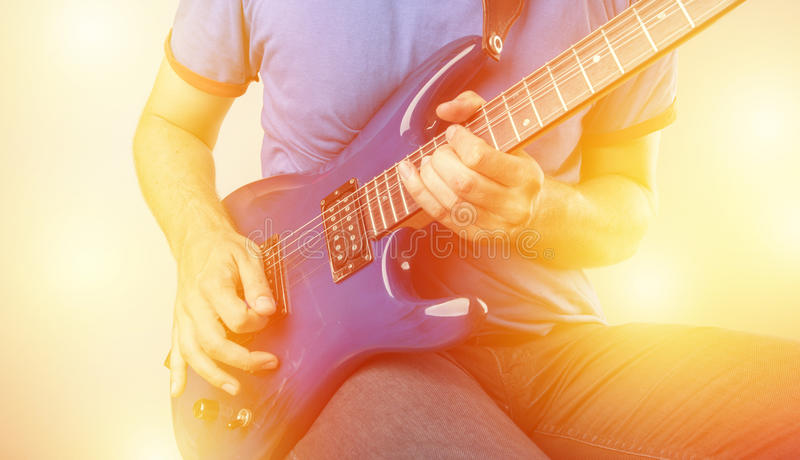 Electric Guitar Player. Guitar Player with guitar in front of his body stock image