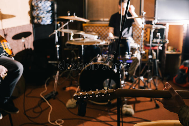Electric guitar riff closeup. Guitarist in studio royalty free stock photography
