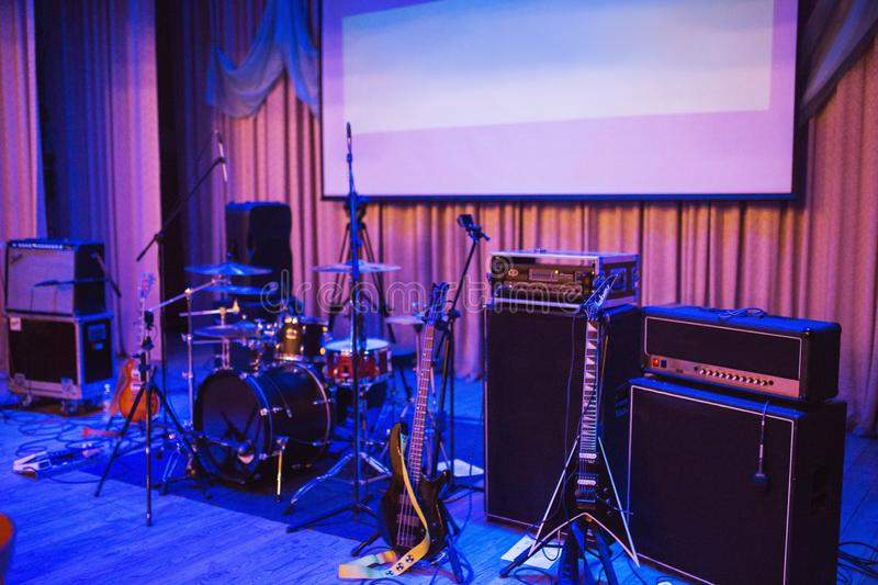 Electric guitar on stage. Electrical concert equipment. Music equipment for a rock concert. Big music speaker. Arts stock photography