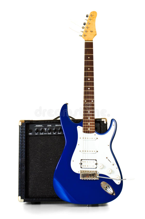 Electric guitar stand in front of amplifier stock image